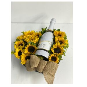 Sunflowers in a box with wine
